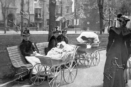 Woman with their perambulators taking babies out for some fresh air.