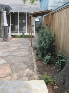 A water permeable patio and outdoor cooking area.