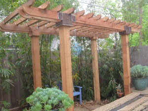 Pergola with welded brackets