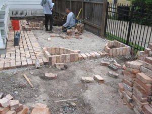 Working out the design in the small brick patio.