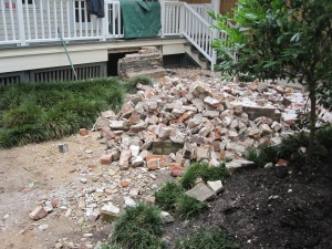 As they broke down the planter the lower bricks began to crumble.