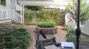 Here is the planter which takes up a lot of space and to the left is an old brick stair that goes to no where.