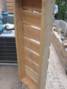 Cedar gate and A/C surround. Designed and constructed by Ravenscourt Landscaping & Design LLC
