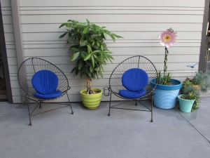 Colorful pots and little seating areas outside the indoor kitchen.