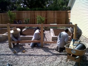Constructing cedar and welded wire fence.