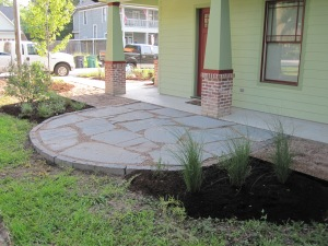 Side yard patio of flagstone and gravel.