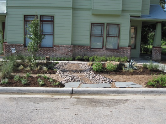Flagstone inset at curb are a landing for guest that park on the street