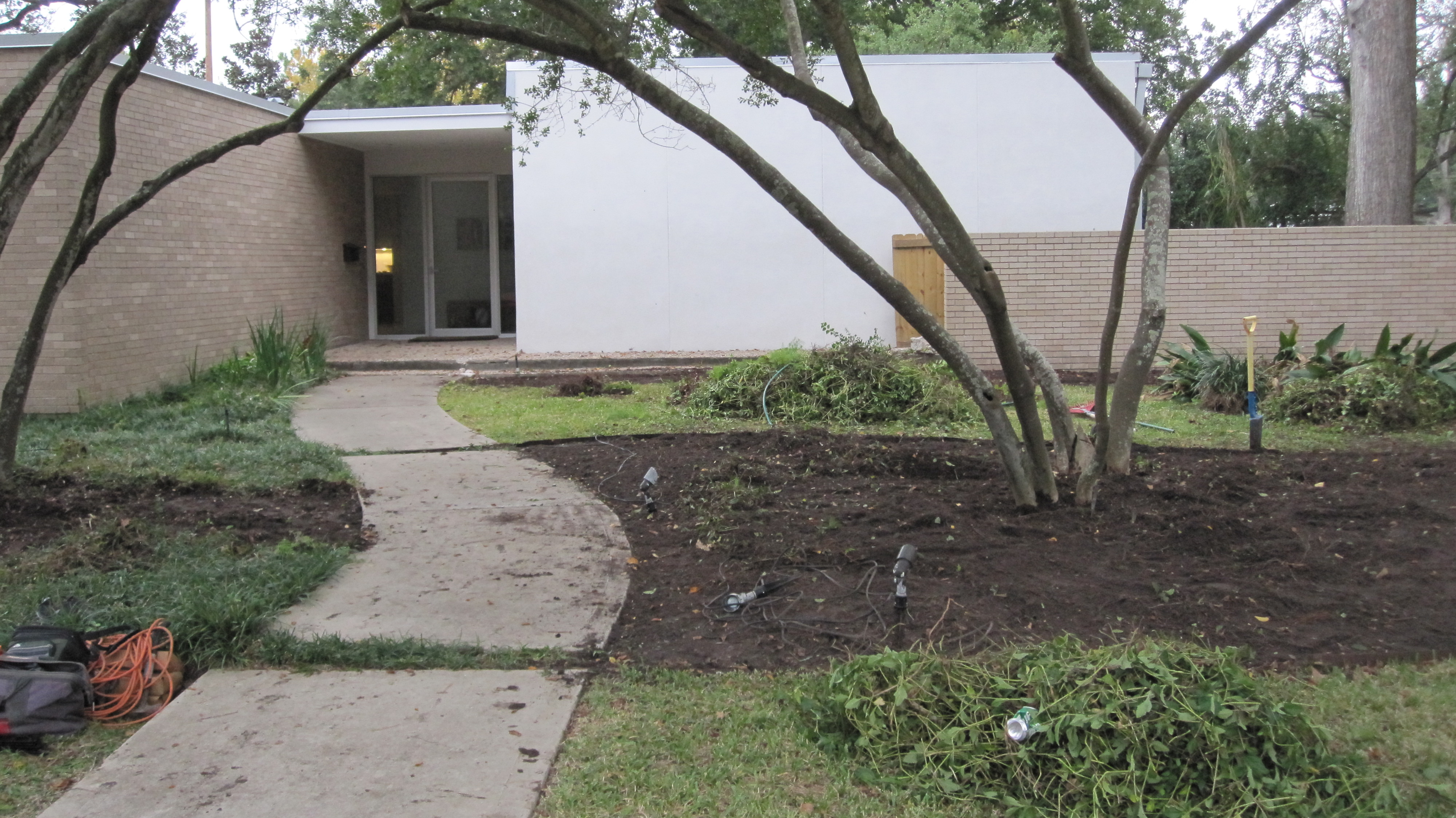 Before just finished cleaning up the beds so we can remake them. New landscaping for a newly remodeled Mid Century Modern