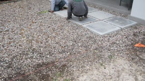 Laying patio in rainbow gravel