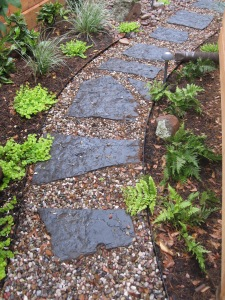 Blue gray flagstone and rainbow gravel path.