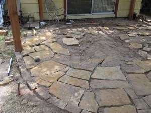 Flagstone cut into dirt.