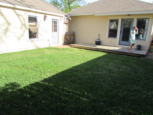 Before shot, nothing but lawn and a small wood deck.