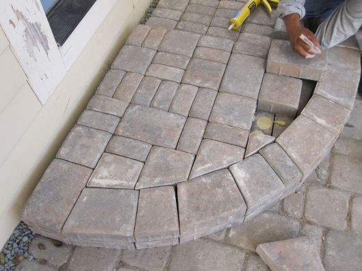 Steps to mimic the shape of the patio.