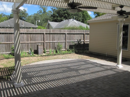 Great shade from the pergola and a view or the new plantings across the back fence.