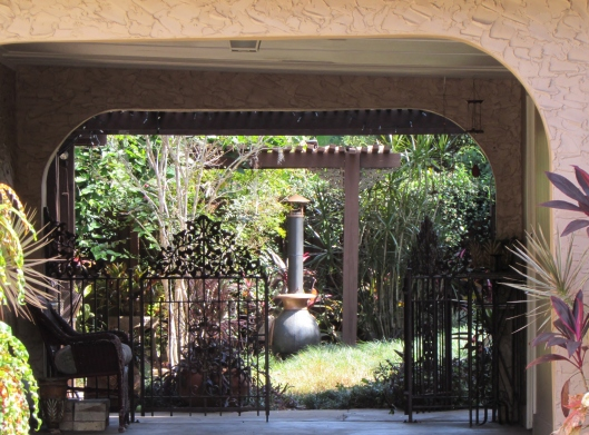A lovely porte cochere leads to the back garden.