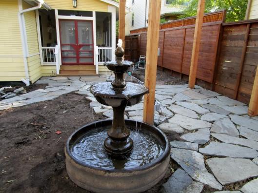 Fountain nestled into patio.