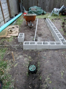 Building the raised herb and vegetable bed.