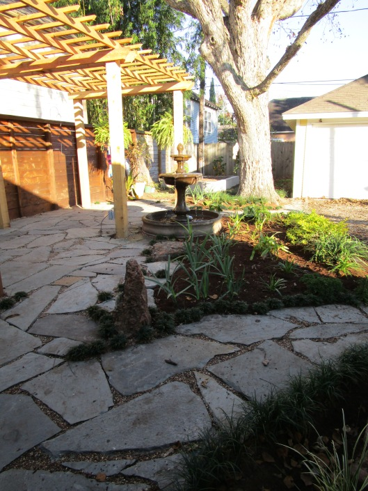 pergola and flagstone patio and paths