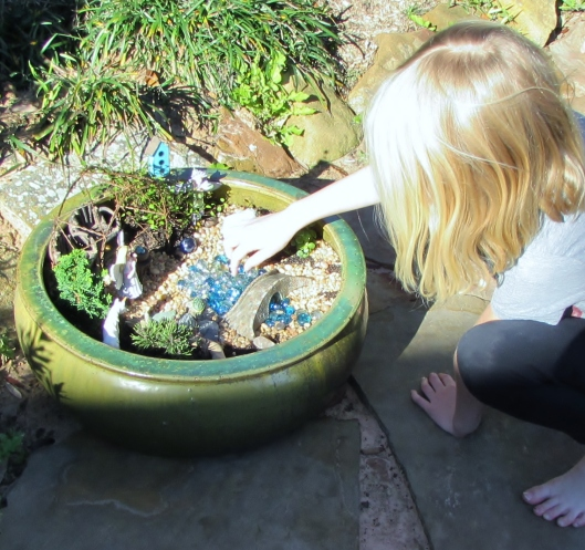 touching the stream in the fairy garden