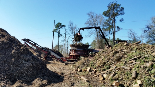 This grinder was operating and they can move a lot of debris quickly with it.