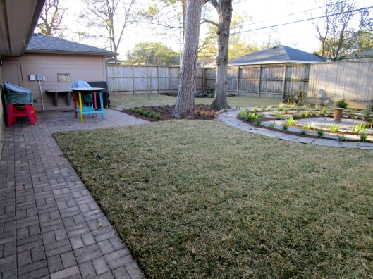 Here you note that the patio is larger and the path is now tight to the house. The space is more cohesive and more functional.