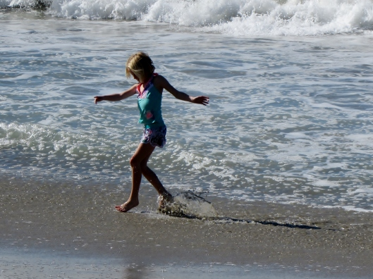 Isabelle (8) dancing in the surf!