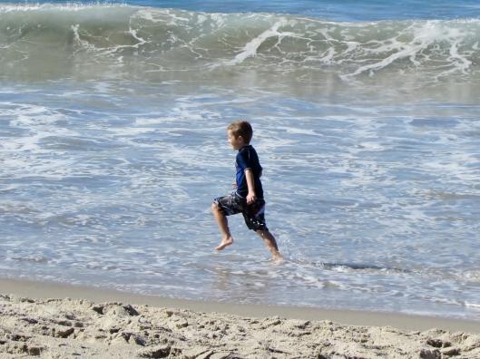 Justin (5) jumping waves!
