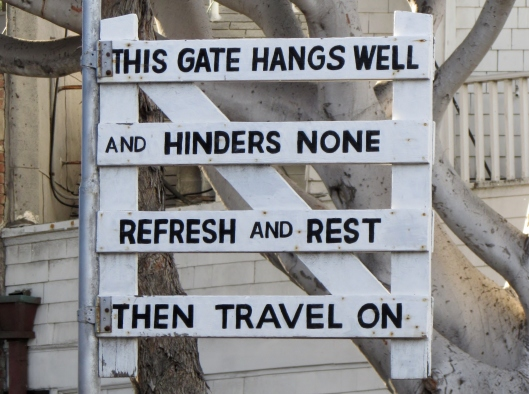 Fun sign high up on a pole.