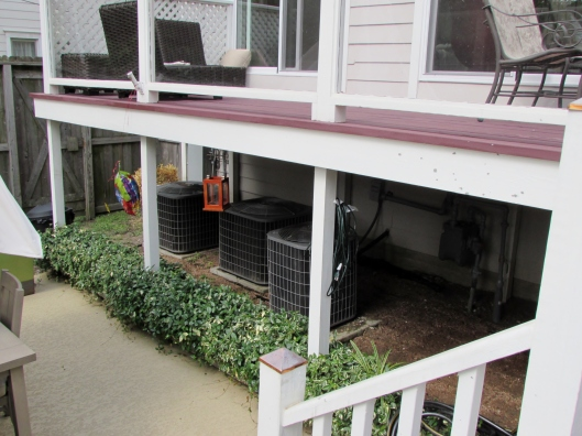deck off house with A/C