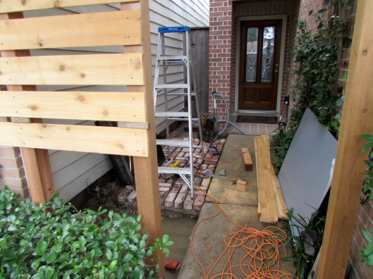 Process cedar screen and brick patio.
