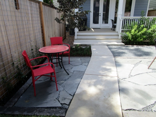 Flagstone patio designed and constructed by Ravenscourt Landscaping & Design LLC.