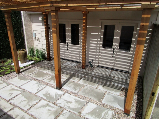 Cement pad and gravel patio.