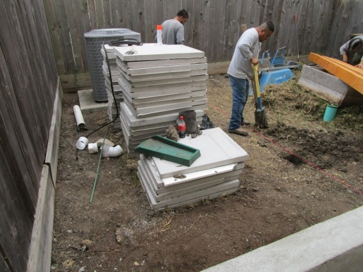 Custom made reinforced cement pad that we will use to create a water permeable patio.