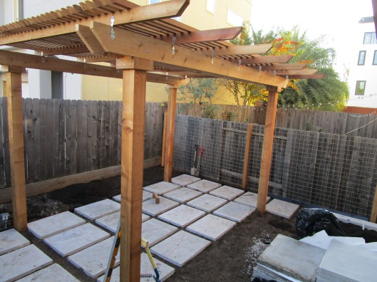 The cement pads are carefully measured and placed.