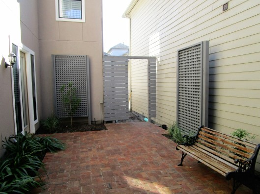 Lattice screens and handmade brick patio.