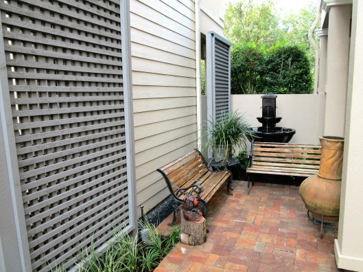 Lattice screens, fountain and sitting area.