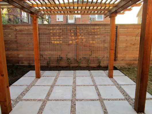 Pergola and cement pad patio