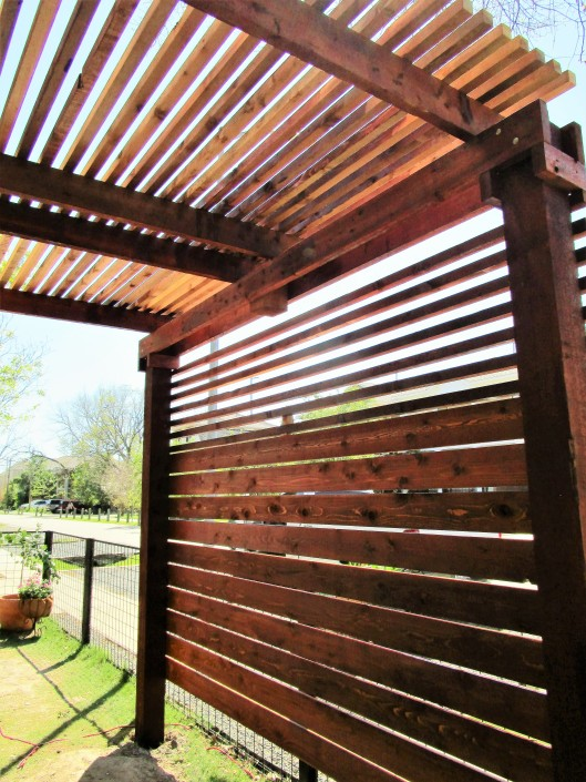 Privacy wall on a pergola