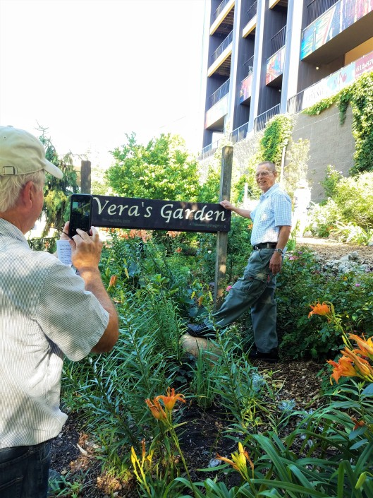 Jim Peterson publisher of Garden Design Magazine take a photo of Designer Donovan Harmel at Vera's Garden.