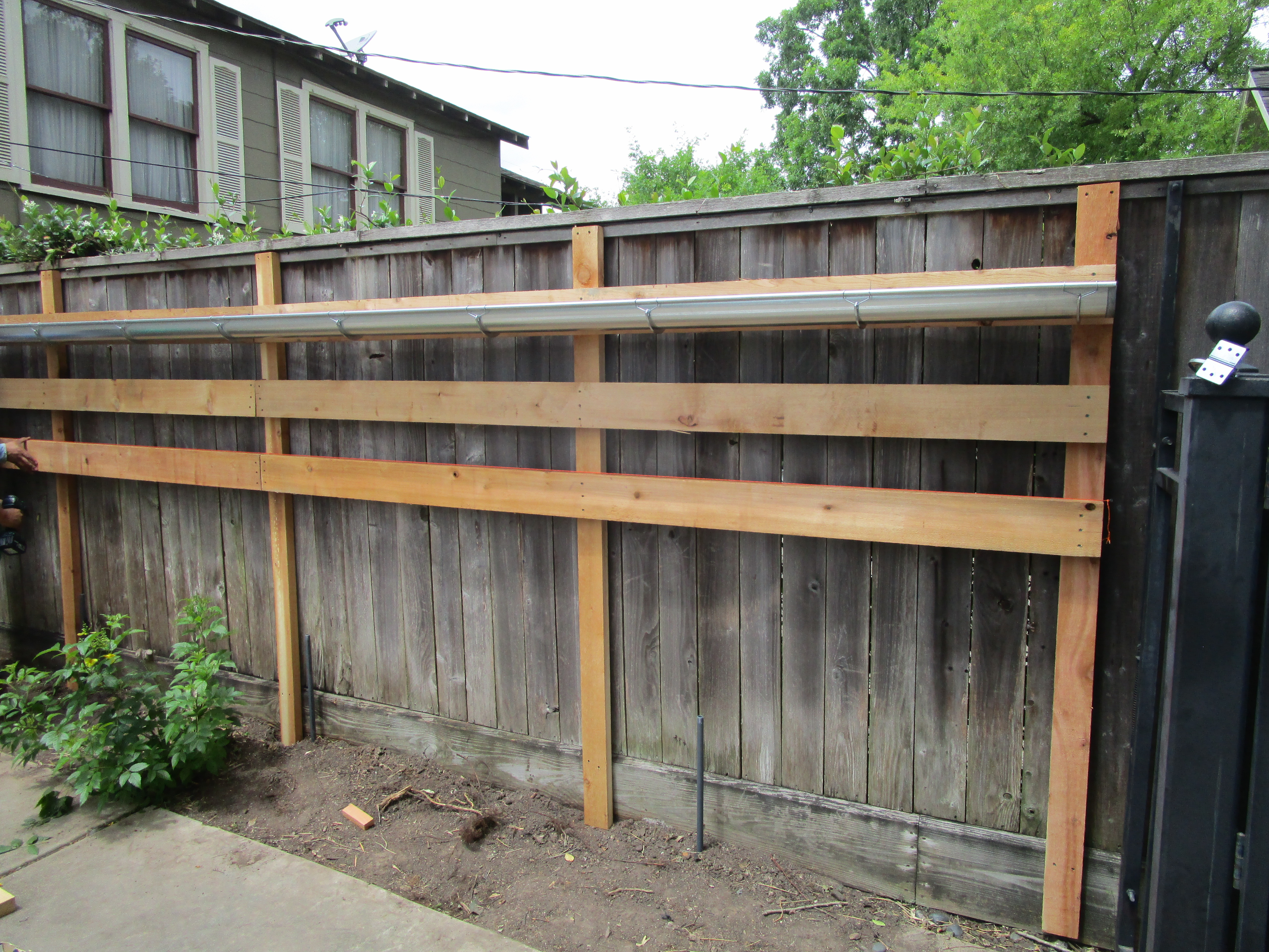 How To Build A Vertical Garden With Rain Gutters